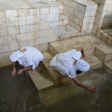 The five days of Parwanaya festival,&nbsp; the most important in the Mandaean calendar, begin with baptism. Ganzibra Najah and Tarmida Sam are performing <i>Tamasha</i> (purifying ritual) in preparation for <i>Masbuta</i> (baptism). This baptism pool was built inside a big room and resourced with water from a nearby creek. It is one of two pools on this site, on a small farm next to a creek around 2 hours drive from Ahvaz. The large room where this pool is situated also contains a <i>shkhenta</i> (a north-facing hut built from mud and bamboo, used for rituals).