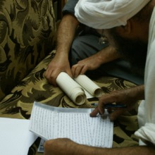 """<p style=""""text-align: center;""""><span>Mandaean&nbsp;</span><span>priests&nbsp;</span><span>and </span><span>shkandi&nbsp;</span><span>read from manuscripts written in <strong><em>Mandaic&nbsp;</em></strong>(a dialect of Aramaic); they must consult a manuscript called </span><strong><em>Sharah&nbsp;Trasa&nbsp;ed&nbsp;Tagha&nbsp;Shishlam&nbsp;</em></strong><span><strong><em>Rba</em></strong>&nbsp;</span><span></span><span>""""The Explanation of the Initiation of King (Angel) </span><span>Shishlam&nbsp;</span><span>The Great"""". Priests who are more knowledgeable about the manuscripts will give instructions on the rituals and actions which need to be taken by the priests. Ganzibra Salam Abdul </span><span>Jabar&nbsp;</span><span></span><span>Kather&nbsp;</span><span>was in charge of this on this occasion.</span></p>"""