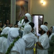 """<div style=""""text-align: center;"""">The initiation of a priest is an important and joyful event in the Mandaean community, both religiously and socially. Usually Mandaeans come to the Mandi, days and nights, for all seven days. Here, the Mandaean community of Baghdad celebrates the end of the seven days of the initiation of Tarmida Anmar and Tarmida Alaa Azeez.&nbsp;</div>"""