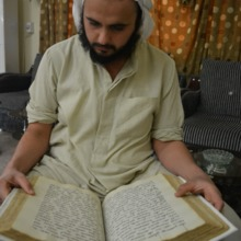 """<p style=""""text-align: center;""""><span>Nasiriya, Iraq, 2015:&nbsp;</span><span>Tarmida&nbsp;</span><span></span><span>Anmar&nbsp;</span><span>reads to Yuhana Nashmi from an old manuscript given to him </span><span>by a </span><span>Mandaean&nbsp;</span><span>elder. Priests are concerned about the preservation of their written literature and constantly look for more knowledge about their religion. The Mandaean elder allows the manuscript to be photographed, keeping the original with him. </span><span>Mandaeans&nbsp;</span><span>venerate their own written manuscripts as bringing blessing and protection to people and their house. </span><span>Mandaean m</span><span>anuscripts are unique, as each copy may differ in its annotations and notes. Tarmida </span><span>Anmar has&nbsp;</span><span>recently begun an initiative to revitalise the art of copying Mandaic manuscripts, preparing his own ink from natural ingredients and studying the scripts. </span></p>"""