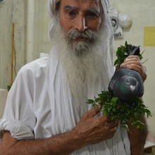 <p><span>Mr Salim </span><span>Choheili&nbsp;</span><span>holds a dove with branches from the myrtle plant. The dove must be free from any type of deformity as it represents the sacred liberated soul. Myrtle is used widely in the </span><span>Mandaean&nbsp;</span><span>rituals; it is one of the sacred trees in the World of Light and symbolises evergreen eternity.&nbsp; </span></p>