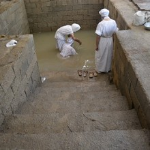 <p>Tarmida Sam baptises Mandaeans in a pool inside the Mandi (temple) – the water comes naturally from a nearby creek. Mandaean priests in Iran still use water from the river daily. Some Mandaeans have raised health concerns about using this water.</p>