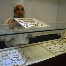 """<p>Ganzibra Taleb Doraji, a well known goldsmith, in his shop in Ahvaz.&nbsp; Mandaean jewellers still have shops in Ahvaz, though few still make handmade jewellery. Ganzibra Taleb said that his favourite type of work is """"engraving on silver"""" and the black enamelwork which is the trademark of Mandaean craftsmanship.</p>"""