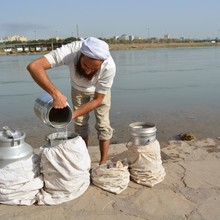 <p><span>Tarmida&nbsp;</span><span></span><span>Behram&nbsp;</span><span>takes water from the River Karun in Ahvaz for daily use.</span></p>