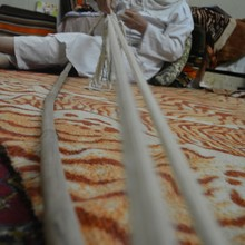 <p>Tarmida Behram's mother weaves a <i>hymiana</i> (religious belt, worn for all religious activities) made from ram's wool. She is one of very few people who still know and practise this tradition. Some of the belts are exported to Mandaeans in the diaspora. Tarmida Behram's mother says that she uses 60 threads in weaving&nbsp; one <i>hymiana</i>, around 1.5 metres in length.</p>